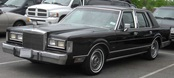 the black Lincoln Town Car graphic