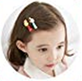 Little girl with barrettes in her hair